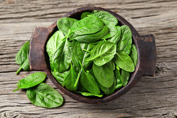 Spinach leaves on wooden background