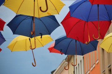Colorful umbrellas in the sky. Seen in the pedestrian zone of Banja Luka, Bosnia and Herzegovina. South-east Europe.