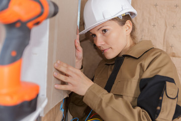 female construction worker indoors