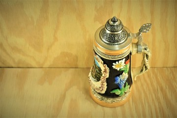 Fototapeta Classic German beer stein on the wooden background  , Summer in Ga USA. obraz