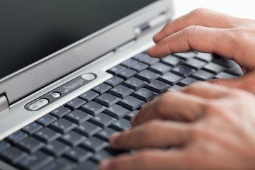 Closeup of a Person Typing on a Laptop Keyboard