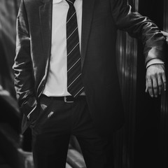 A man posing in a suit