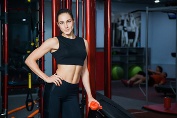 Fit and healthy young female model bodybuilder at gym. Sporty active lifestyle concept. Bodybuilding and healthy way of life