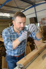 Carpenter using compass