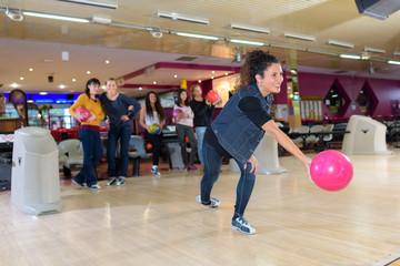 Lady launching bowling ball