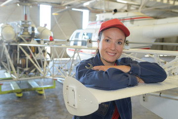 Portrait of woman in aircraft hangar