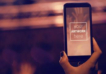 Phone in Crowd Mockup