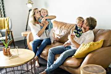 Family having fun on sofa.