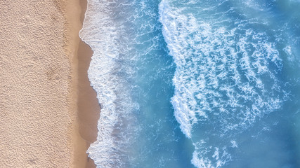 Wave on the beach as a background. Beautiful natural background at the summer time. Aerial seascape from drone at the summer time