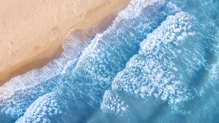 Poster de jardin Eau Wave on the beach as a background. Beautiful natural background at the summer time. Aerial seascape from drone at the summer time