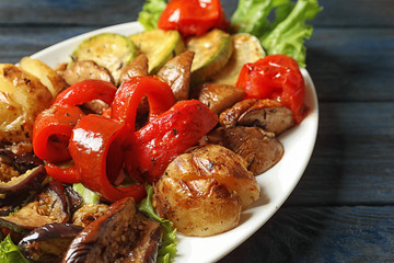 Plate with tasty grilled vegetables on table, closeup