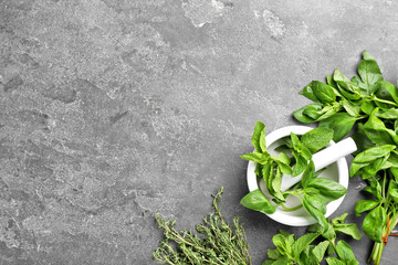 Flat lay composition with fresh green herbs on grey background