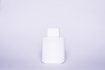 Isolated white bottle on a light gray background. A bottle with an empty space ready to be completed in the form of a mock-up.