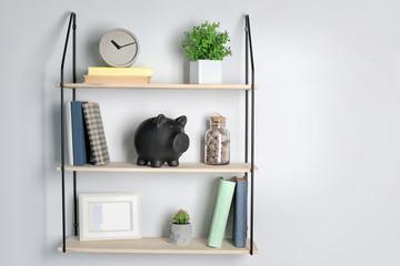Cute piggy bank on shelf indoors. Stylish interior