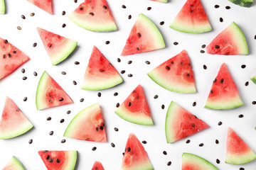 Flat lay composition with slices and seeds of watermelon on white background