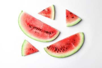 Flat lay composition with slices of watermelon on white background