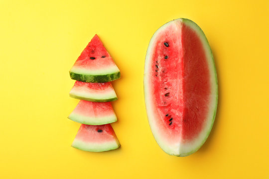 Flat lay composition with slices of watermelon on color background