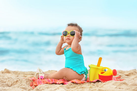 Adorable African-American girl on beach