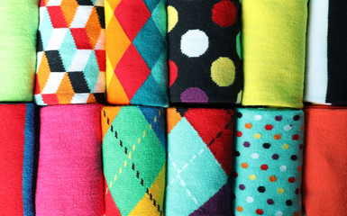 Different colorful socks as background, closeup