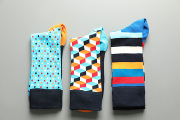 Fototapete - Flat lay composition with different colorful socks on gray background