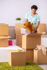Young man moving to new apartment
