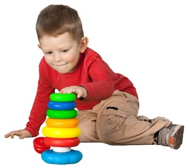 Friendly Little Boy Sitting on Ground and Playing with Toys -