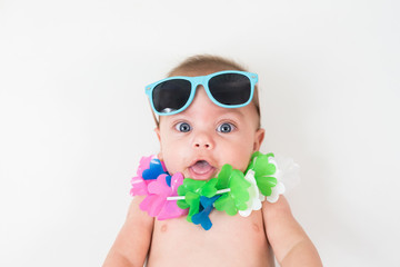 Funny baby boy wearing Hawaii costume - Isolated background