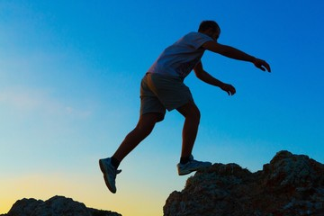 Man Walking on Rocks