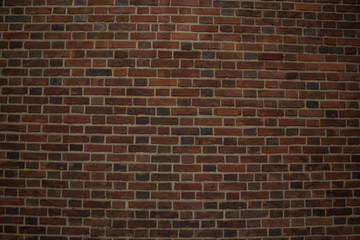 dark brown brick wall background texture with empty space for copy or text