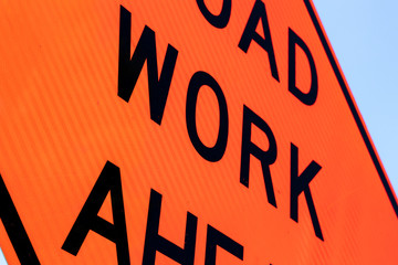 Road work ahead sign close up abstract