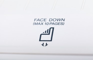 Close-up of a Paper Direction Icon on a Fax Machine