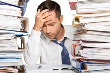 Closeup of an Exhausted Businessman with Stack of Folders