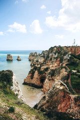 Beautiful views of the Atlantic Ocean and the rocks off the coast of Portugal next to the city called Lagos. Amazing natural landscape.