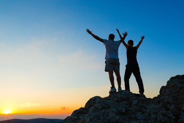 Two Men Celebrating on Mountain Top