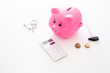 Money for buy car. Moneybox in shape of pig near keychain in shape of car, coins, calculator on white background copy space