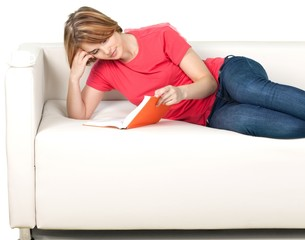 Woman reading book on sofa isolated on white background