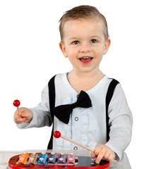 Friendly Little Boy Smiling and Playing the Xylophone - Isolated