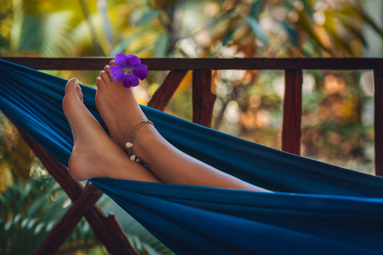 woman feet close up lying in hammock