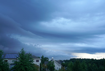dark storm cloud on the sky above residential area