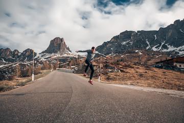 Handsome man amazing mountains background, sport, running, back portrait