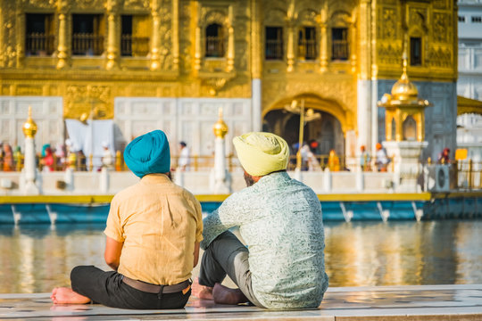 Sikh devotees in front of the Golden temple in Amritsar, India