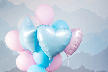 Blue and pink balloons in studio. Close up picture