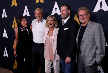 "Director of the movie Kleiser and cast members Conn, Pearl, Newton-John and Travolta pose at a 40th anniversary screening of ""Grease"" at the Academy of Motion Picture Arts and Sciences in Beverly Hills"