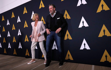 """Cast members Travolta and Newton-John dance at a 40th anniversary screening of """"Grease"""" at the Academy of Motion Picture Arts and Sciences in Beverly Hills"""
