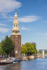 Historical tower Montelbaanstoren in Amsterdam, Netherlands