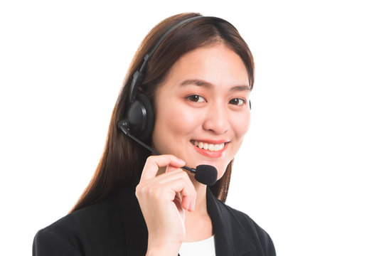 Portrait of Asian beautiful smiling woman customer support phone operator isolated on white background and copy space.Concept call center job service.