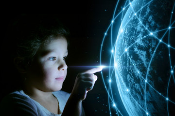 little girl touches a virtual world with multimedia connections. concept of future and communication with the digital world.