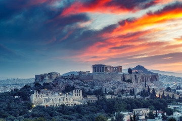 The Acropolis in Athens, Greece at sunrise. Scenic travel background with dramatic sky.