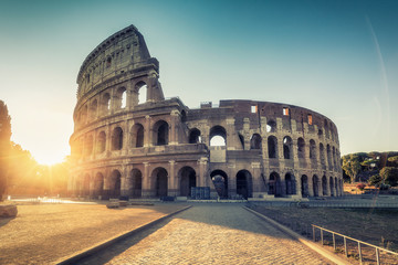 Photo sur Aluminium Rome Colosseum in Rome, Italy at sunrise. Colourful travel background.