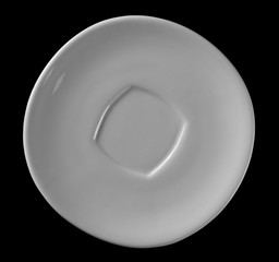 White, empty ceramic saucer isolated on white background, top view with clipping path